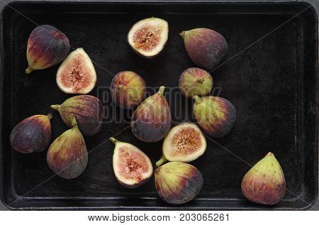 Fresh figs whole and halves with room for text