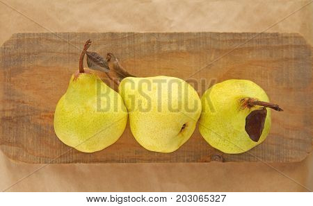 Three pears on a piece of weathered wood with room for text