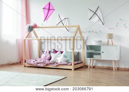 Bedroom With Cupboard And Kites