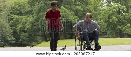 Walking with a friend on a wheelchair