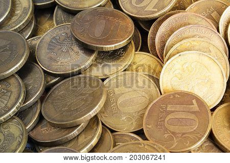 Background from ten-ruble coins. Coins of ten rubles. Indoors. Horizontal format. Color. Photo.