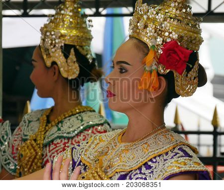 BANGKOK, THAILAND--Two female cultural dancers who perform at the Erawan Shrine to pay homage to the victims of the bombing in 2015 at Pathum Wan District, Bangkok. Photo taken in March 2016.