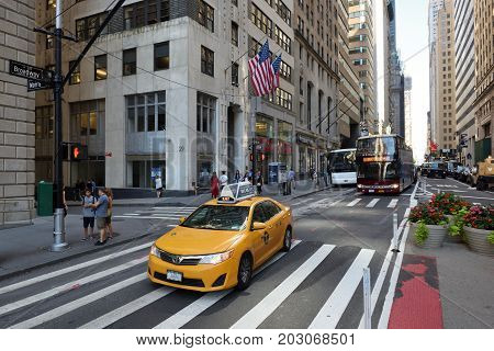 NEW YORK CITY USA - AUG. 23 : Yellow taxi on street in Manhattan on August 23 2017 in New York City NY. Manhattan is the most densely populated borough of New York City.