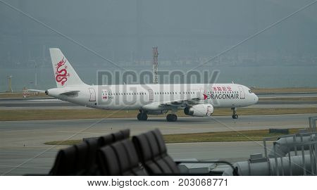HONG KONG--A Dragon Air plane gets ready to take off from the runway of the Hong Kong International Airport in Chek Lap Kok in December 2016.
