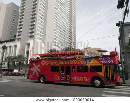 NEW ORLEANS, LOUISIANA--An open-top double-decker  Hop-On, Hop-Off city sightseeing bus traveling at the downtown area in New Orleans in January 2017.