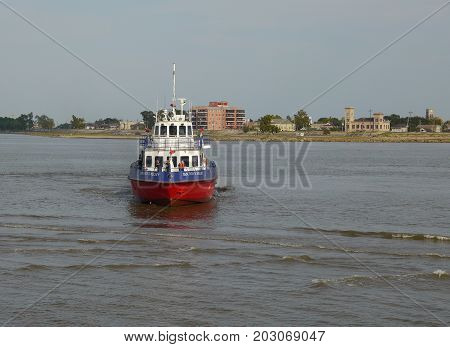 NEW ORLEANS, LOUISIANA--A Coast Guard vessel patrols the Mississippi River facing the Riverwalk in New Orleans, Louisiana in August 2015.