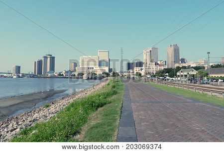 NEW ORLEANS, LOUSIANA--View of the Riverwalk beside the Mississippi River with hotels and buildings taken in August 2015.