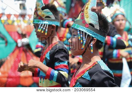 DAVAO CITY, PHILIPPINES--AUGUST 2014: Kids in colorful costumes at the Kadayawan streetdancing parade  Kadayawan is celebrated August each year to give thanks for life and an abundant harvest.