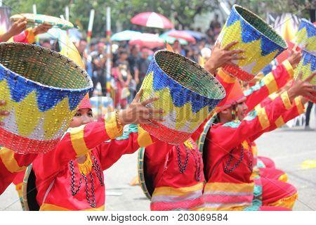 DAVAO CITY, PHILIPPINES--AUGUST 2014: Kadayawan performers use native props for their streetdancing. Kadayawan is celebrated August each year to give thanks for life and an abundant harvest.
