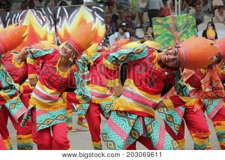 DAVAO CITY, PHILIPPINES--AUGUST 2014: Streetdancers in smiles as they perform at the streets of Davao.  Kadayawan is celebrated August each year to give thanks for life and an abundant harvest.
