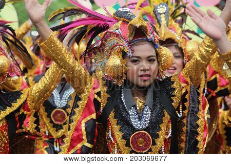 DAVAO CITY, PHILIPPINES--AUGUST 2014: One of the participating teams for the Kadayawan Festival in Davao City. Kadayawan is celebrated August each year to give thanks for life and an abundant harvest.