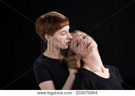 Young Woman Leaning On Girlfriend