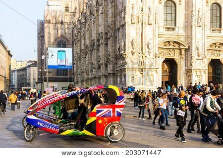 MILAN, ITALY - March 16, 2017: street view of Milan Cathedral, Domm de Milan is the cathedral church