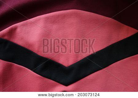 Black Angled Stripe Stitched To Pink Stockinette Fabric