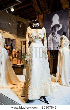 Riga, Latvia - July 5, 2012 - Tulle and velvet retro ball qown with machine made lace applique. Florence, 1903-1904. Historic fashionable design. Lovely dress champagne color for wedding ideas.