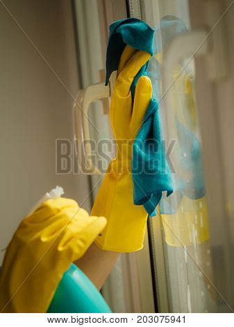 Hand Cleaning Window At Home Using Detergent Rag