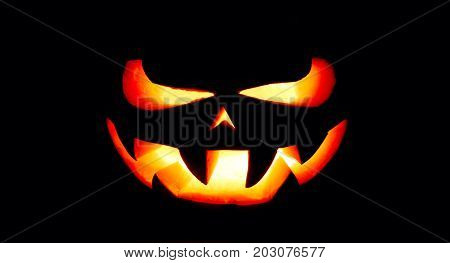 A Very Terrible Halloween Pumpkin, With A Terrible Look And A Smirk Of A Villain, In The Dark