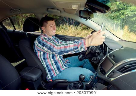Handsome Young Business Man Taking Selfie Using Smart Phone While Sitting At The Front Seat Of His C