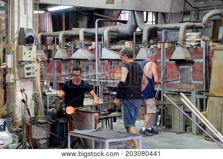 VENICE,ITALY - JULY 27,2017 : Glassmakers wotking at a factory on the island of Murano near Venice