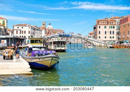 VENICE,ITALY - JULY 25,2017 : A The Grand Canal and the Ponte degli Scalzi in Venice