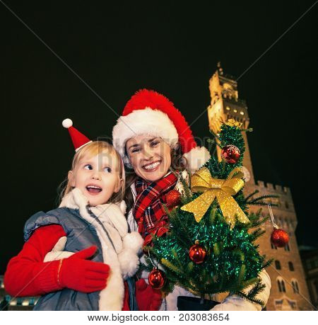 Mother And Daughter Tourists With Christmas Tree In Florence