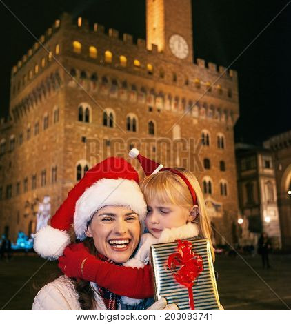 Mother And Child Tourists With Christmas Present Box In Florence