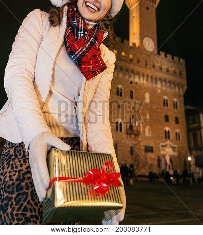 Woman Against Palazzo Vecchio Showing Christmas Present Box