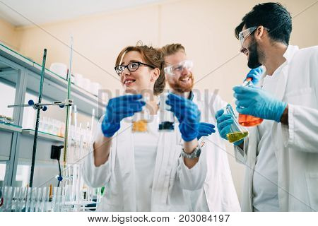 Group of chemistry students working together in laboratory