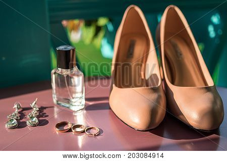 Wedding Accessories, Selective Focus. Bridal Shoes, Jewelry, Perfume Bottle, Tree Wedding And Engage