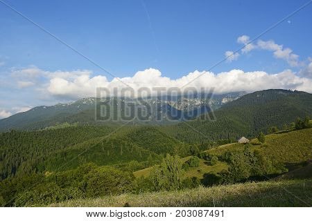 Evening And Sunset On Mountain Hills Of Simon Village. Bran. Romaniaevening And Sunset On Mountain H