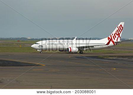 SYDNEY, AUSTRALIA - APRIL 3, 2014: Aircraft of the Virgin Australia fleet taxiing to takeoff at Sydney Airport.