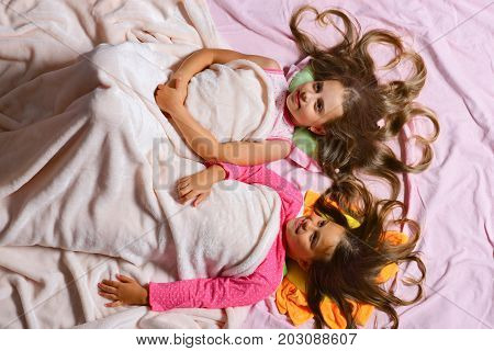 Kids With Happy Faces And Hearts In Hair In Bed