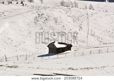 Winter Landscape With A Wooden Hut In The Mountains In Bucegi. Romania, Carpathian Mountains