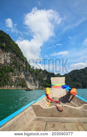 Point of view of Cheow Lan lake from long tail boat at Khao Sok National Park in Thailand