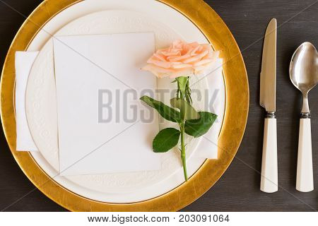 Tableware - set of plates and utencils with rose flower and empty white card