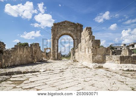Al-Bass, Byzantine road with triumph arch with blue sky and clouds in ruins of Tyre, Lebanon