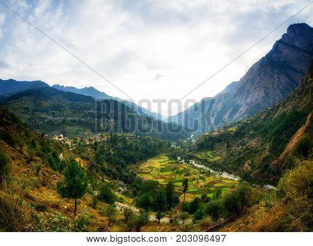 Himalayan village general view from road in Parvati Valley, Himachal Pradesh