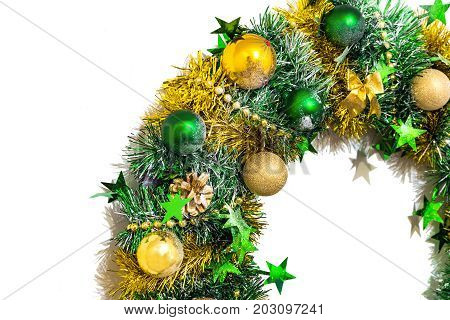 Golden green shiny Christmas decoration of tinsel bows balls beads cones and stars