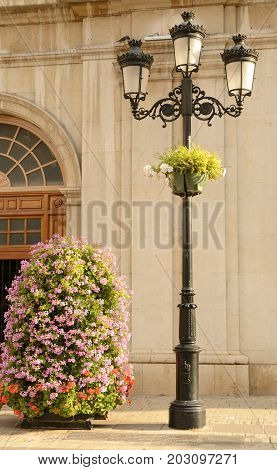 Urban lamp and floral center at the streets of Castellon Valencian Community Spain.