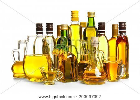 Composition with cooking oil and sunflower on white background