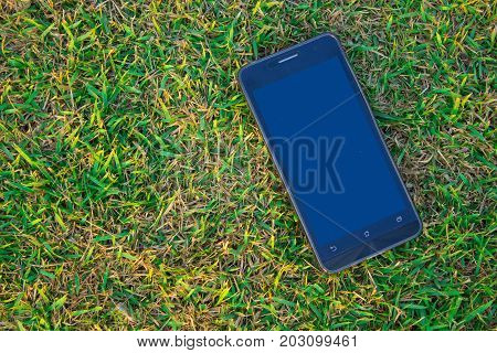 Smart Phone On The Ground With Copy Space , The Technology Of Communication Every Body Have Use Ever