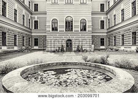 Courtyard of the forestry school in old mining town Banska Stiavnica Slovak republic. Travel destination. Black and white photo.