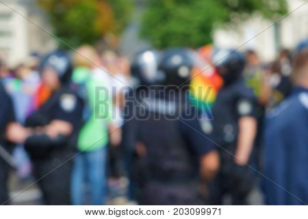 Concept of sexual minority. Blurred view of crowd at gay pride outdoors