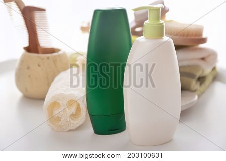 Composition with bath cosmetics and accessories on table
