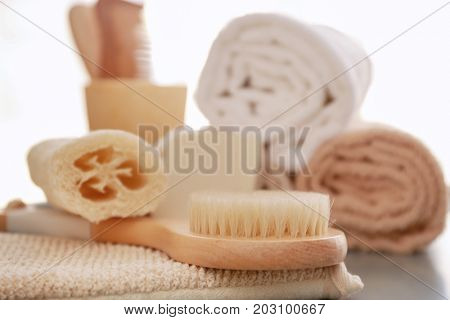 Composition with bath accessories on table