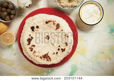 Home made pita bread, flatbread popular in turkish, lebanese, levantine and other oriental cuisines