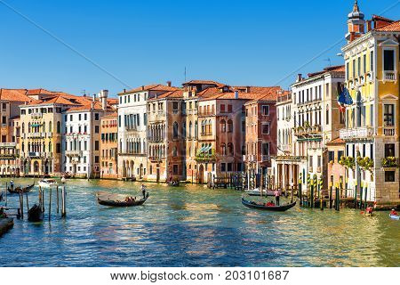 The famous Grand Canal with gondolas on a sunny day in Venice, Italy. Grand Canal is one of the major water-traffic corridors and tourist attraction in Venice.