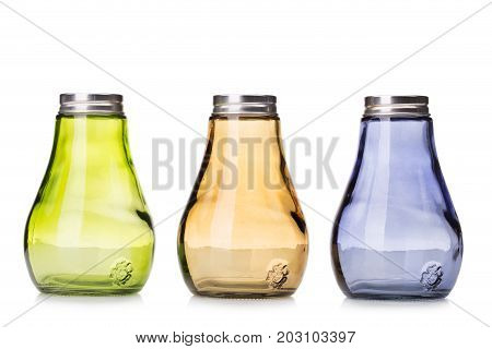 Three yellow, blue and orange salt and pepper shakers, colorful salt and pepper pots, small containers for salt and pepper isolated on a white background.