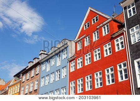 Colorful facades of buildings in Nyhavn Copenhagen Denmark.