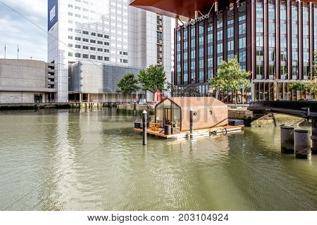 ROTTERDAM, NETHERLANDS - August 05, 2017: View on the Wijn port with house on the water and office buildings in Rotterdam